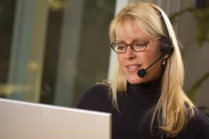 Businesswoman talks on her phone headset.