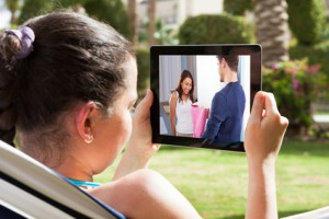 Close-up Of Young Woman Watching Movie On Digital Tablet