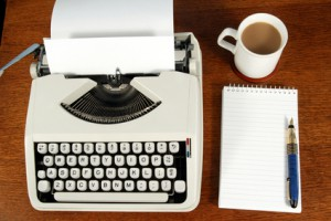 A writer's typewriter and desk.